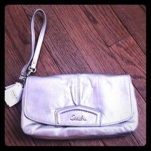 Silver coach clutch purse